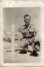 Bill Smith next to his brother John's grave in Egypt 1942